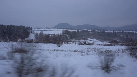 Traveling with train snowy fields and mountains GIF