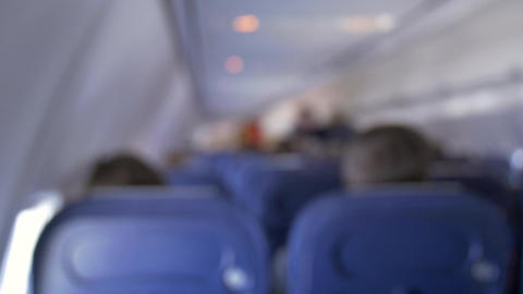 Inside Airplane Cabin - People Out Of Focus On Board Aircraft stock footage