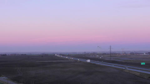 Rural Traffic at Sunset - Wind Farm + Cars Footage