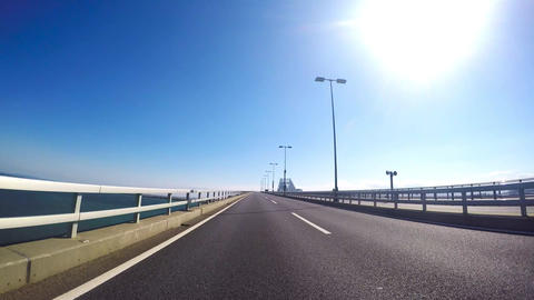 Blue sky of a vehicle-mounted video. Traveling by car the Tokyo Gate Bridge in T Footage