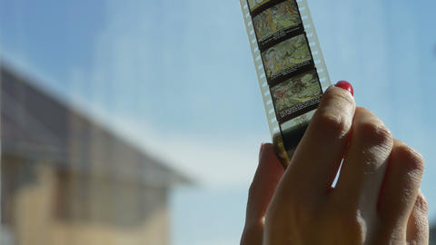 Woman Unrolling Cartoons Filmstrip stock footage