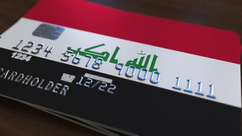 Plastic bank card featuring flag of Iraq. Iraqi national banking system related フォト