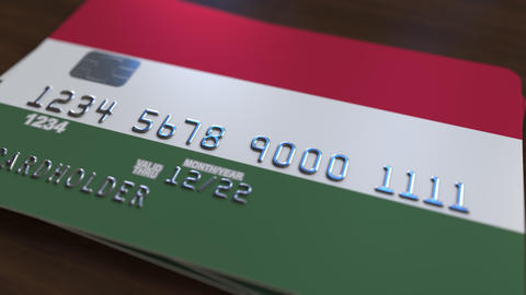 Plastic bank card featuring flag of Hungary. Hungarian national banking system Live Action