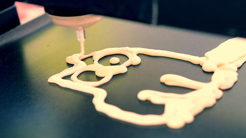 3D printer for liquid dough. 3D printer printing pancakes with liquid dough Live Action