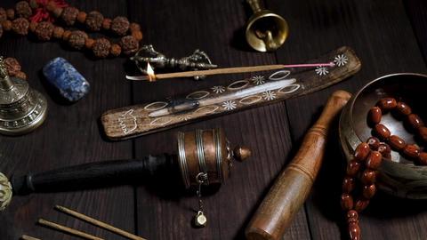Copper singing bowl, prayer beads, prayer drum, stone balls Footage