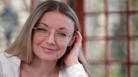 Woman wearing spectacles smiles Live Action
