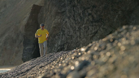Man runs along the coast Footage