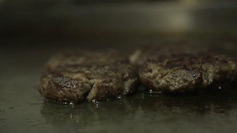 Meat Patty - Cooked Beef Patties On The Griddle - Side Angle Live Action