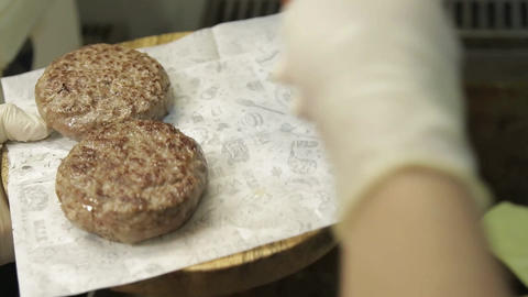 Meat Patty - Taking Cooked Beef Paties Off The Griddle - Side Angle - Side Angle Live Action