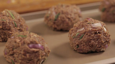 Meat Patty Mixture - Meat Balls On A Tray - Pan - Left To Right - Side Angle Live Action
