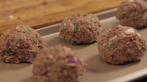 Meat Patty Mixture - Meat Balls On A Tray - Slider - Left To Right - Side Angle Live Action