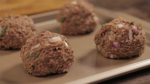 Meat Patty Mixture - Meat Balls On A Tray - Pan - Right To Left - Side Angle Live Action