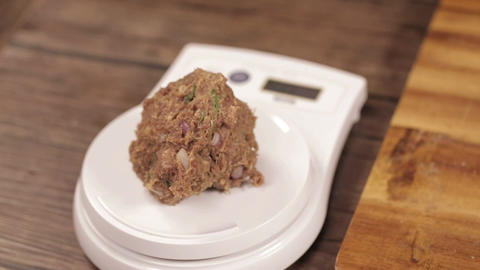 Meat Patty Mixture - Making Meat Balls With Hands and Weighing It - Front Angle Live Action