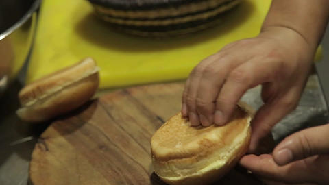 Buns - Putting Buttered Round Fresh Buns In Basket Footage