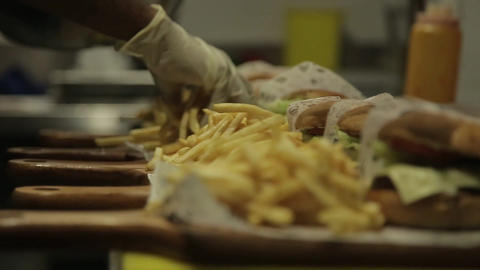 French Fries - Putting French Fries Next To Burgers - Focus Pull - Hand held - Footage