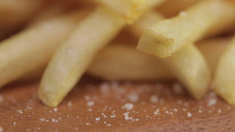 French Fries - French Fries With Salt Close Up - Tilt - Bottom To Top Footage