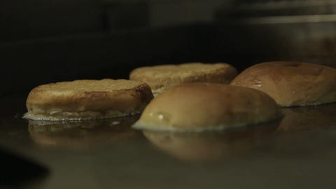 Buns - Toasting Round Fresh Buns On Griddle - Side Angle Footage