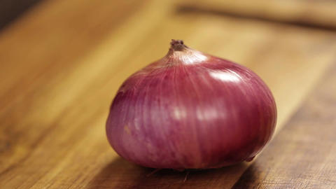 Red Onion - Cutting Red Onion On A Wooden Board - Side Angle Footage