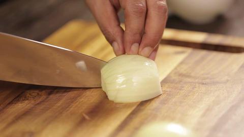 White Onions - Cutting White Onion In Small Pieces On A Wodden Cutting Board - Live Action