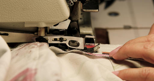 Professional sewing machine overlock with white fabric close-up ビデオ