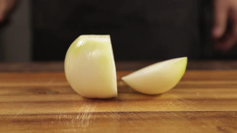 White Onions - Chopping White Onion With A Knnife - Front Angle Live Action