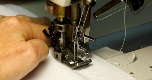 Woman sewing on sewing machine, sewing machine with two needles, fashion sewing Live Action
