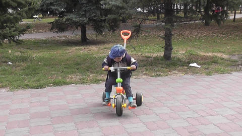 Little boy on bicycle in park Live Action