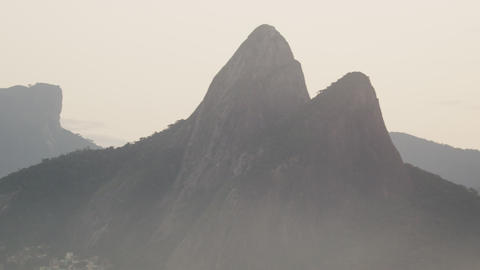 Tracking shot of Dois Irmãos mountains, the Vidigal favela, and houses Footage