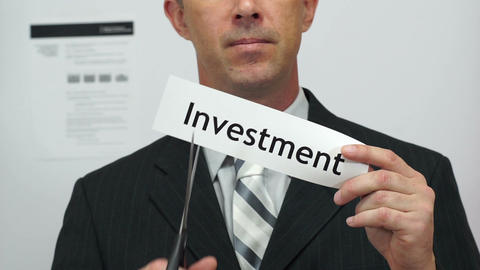 Businessman Cuts Investment Concept Footage