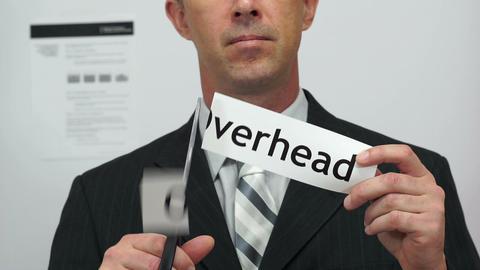 Businessman Cuts Overhead Concept stock footage