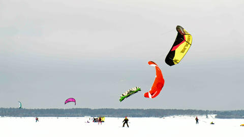 CHEBOKSARY, RUSSIA - DECEMBER 31, 2018: snowkiting athletes ride on the river in Live Action