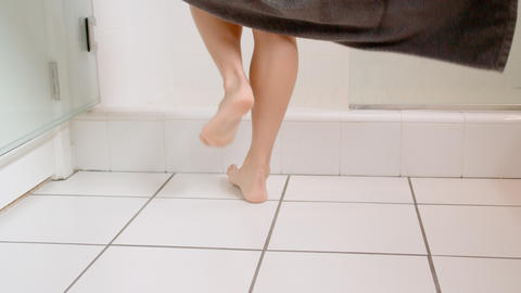 Attractive woman drops her towel as she enters the shower GIF