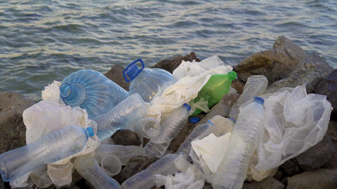 Plastic pollution in ocean environmental problem. Plastic cups,carrier bags Footage
