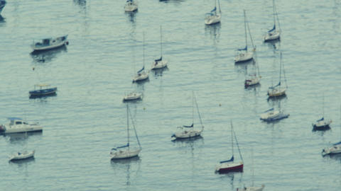 Slow-motion pan shot of boats sitting in the water near Avenida Portugal Footage