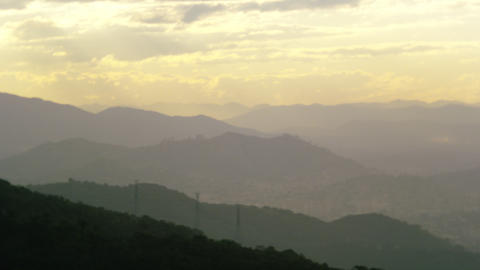 Different levels of hills rise under the morning sky in Rio de Janeiro Footage