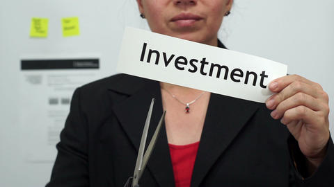 Businesswoman Cuts Investment Concept Footage