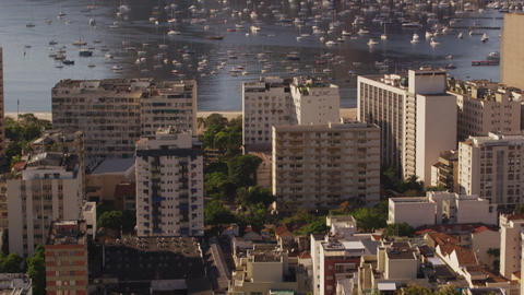 Vertical tracking shot of Rio de Janeiro's buildings, beach, and mountains Footage