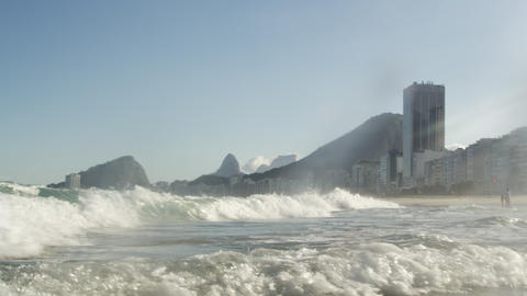 The tide crashing into the shores of Copacabana - Rio de Janeiro, Brazil Footage