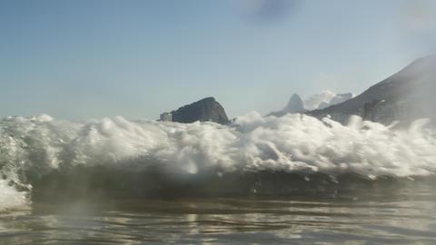 A wave, off the coast of Copacabana, travels into shore - Rio de Janeiro, Brazil Footage