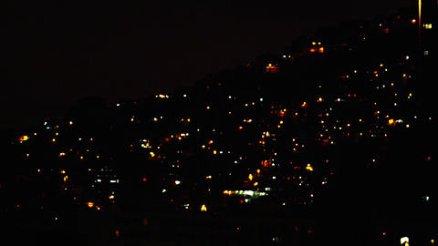 Rack focus- shot of city lights glowing in the hills of downtown Rio De Janeiro Footage