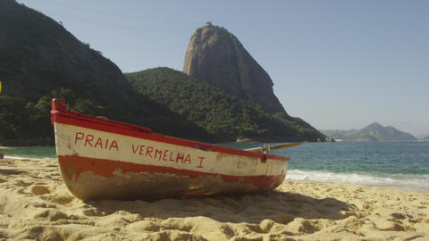 Slow motion of a fishing skiff on Red Beach in Rio Footage