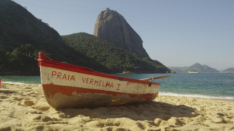 Slow motion pan of a fishing skiff on Red Beach in Rio Footage