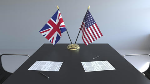 Flags of Great Britain and the United States and papers on the table Footage