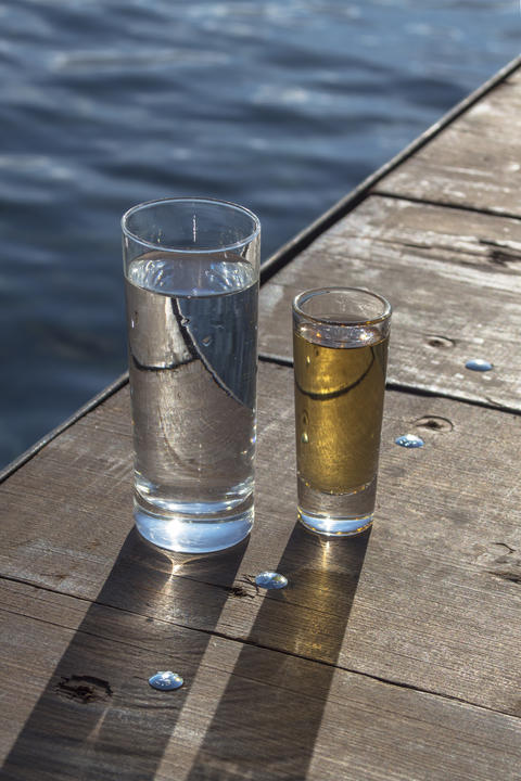 A glass of water and a glass of alcohol on the bridge Photo