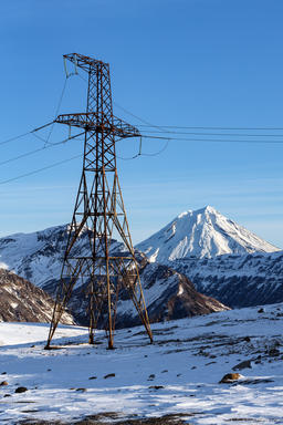 High voltage power line in mountain at winter sunny day フォト
