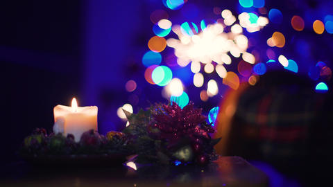 Christmas Candle and Sparks of Bengal Light on Christmas Tree. Diff. 4k Footage