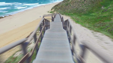 Walk Down via Wooden Stairs with Railing Footage