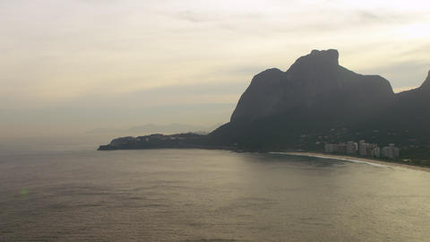 Panning aerial footage of Rio shore and cliffs Footage