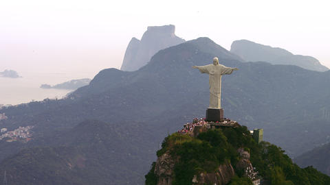 Aerial shot of Christ statue and surrounding mountains and city Footage