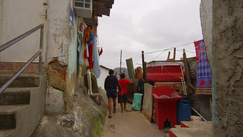 Slow dolly shot of kids walking in a favela on June 23, 2013 in Rio de Janeiro,  Footage